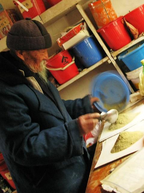 Dr. Ho prepares Todd's medicine - Baisha, near Lijiang, China