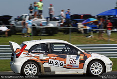 rallying(0.0), ford focus rs wrc(0.0), touring car(0.0), race car(1.0), auto racing(1.0), automobile(1.0), touring car racing(1.0), racing(1.0), vehicle(1.0), sports(1.0), motorsport(1.0), rallycross(1.0), city car(1.0), world rally car(1.0), world rally championship(1.0), sports car(1.0),