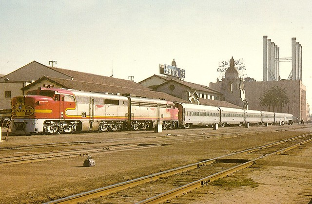 ATSF0002 A pair of Alco PA's with 77 in the lead, are ready to depart Santa Fe's San Diego mission style station for a run to Los Angeles in 1957 (Mac Owen)