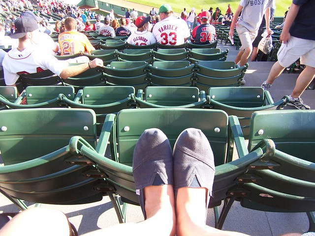 anna wears her navy canvas classic toms at fenway park