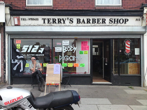 Pirate outdoors terry s barber shop find me a tattoo for Find tattoo parlor