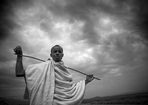 Karrayyu man with a stick, Ethiopia
