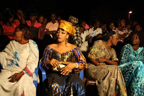 <p>Oumou Sow waits for her turn in the spotlight by watching the dancers do their thing.</p>