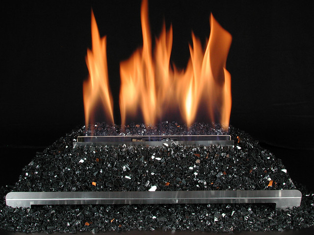 ventless gas log fireplace with black fire glass