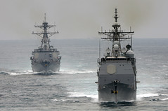 In this file photo, guided-missile cruiser USS Cape St. George (CG 71) and guided-missile destroyer USS Sterett (DDG 104) are underway in the Pacific Ocean during a composite training unit exercise.  (U.S. Navy photo by Mass Communication Specialist 2nd Class Arif Patani)