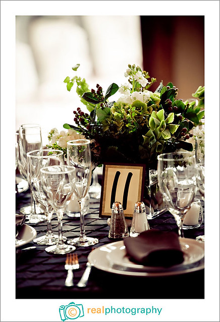 green and brown wedding reception table centerpiece and linens