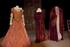 red(0.0), sari(0.0), pink(0.0), pattern(1.0), textile(1.0), gown(1.0), clothing(1.0), costume design(1.0), maroon(1.0), fashion(1.0), formal wear(1.0), fashion design(1.0), haute couture(1.0), dress(1.0),