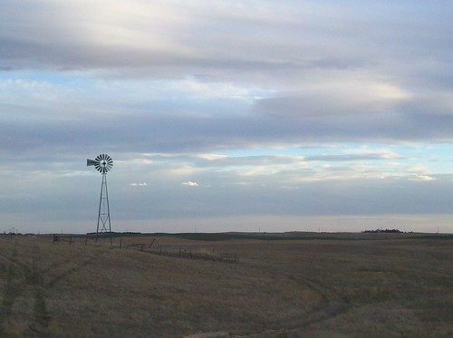 sunset windmill clouds nebraska dirtroad northplatte