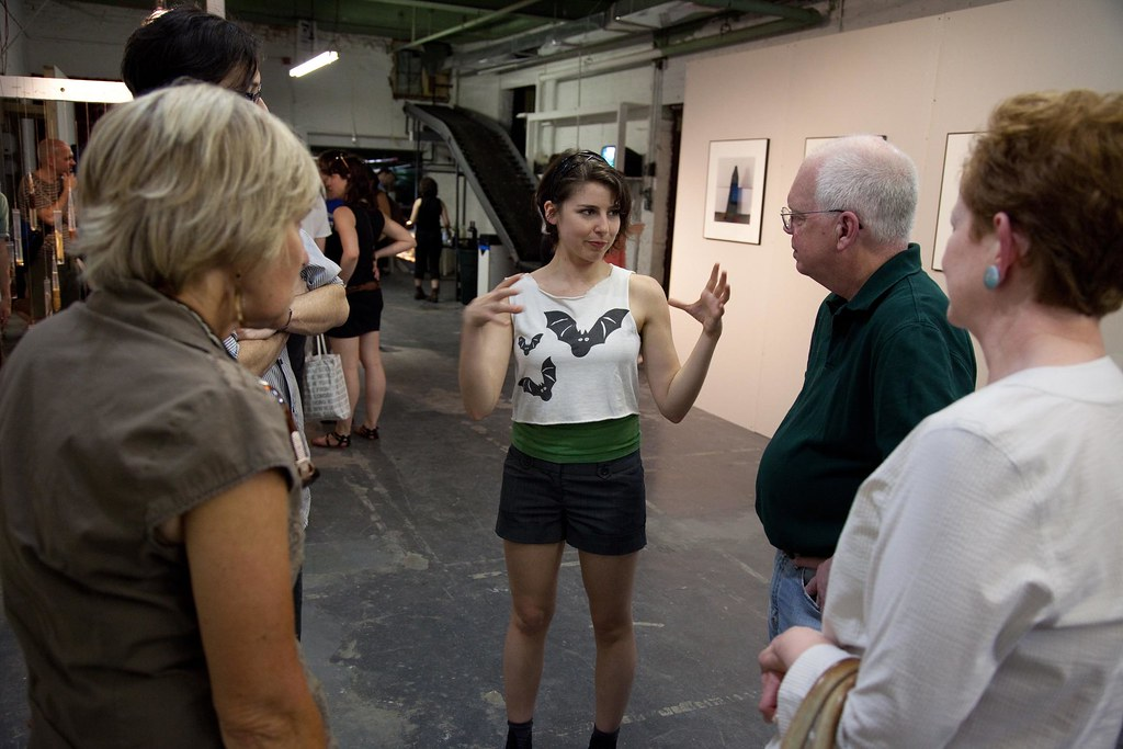 Andrea Minicozzi (M.F.A. '10) explaining her work to visitors.