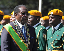 President Robert Mugabe inspects the guard of honour during the opening ceremony of the Parliament in Harare, Tuesday, July, 13, 2010. The Southern African state has established a coalition government and is drafting a new constitution. by Pan-African News Wire File Photos