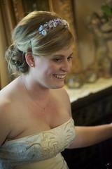 veil(0.0), bridal veil(0.0), bridal clothing(1.0), hairstyle(1.0), gown(1.0), clothing(1.0), wedding(1.0), hair(1.0), woman(1.0), female(1.0), headpiece(1.0), wedding dress(1.0), portrait(1.0), dress(1.0),