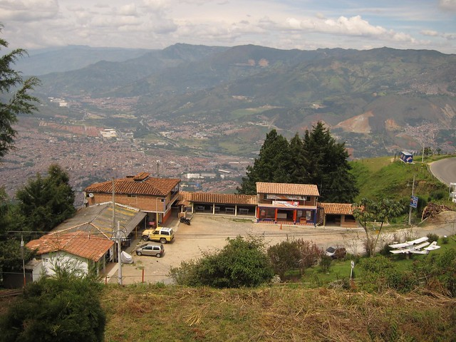 The small collection of paragliding shops perched below the takeoff and landing area.