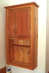 wardrobe(0.0), furniture(1.0), wood(1.0), chiffonier(1.0), room(1.0), cupboard(1.0), wood stain(1.0), door(1.0), hardwood(1.0), cabinetry(1.0),