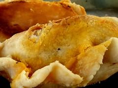fish and chips(0.0), pot pie(0.0), wonton(0.0), empanada(0.0), frying(1.0), deep frying(1.0), fried food(1.0), baked goods(1.0), food(1.0), dish(1.0), dessert(1.0), cuisine(1.0),