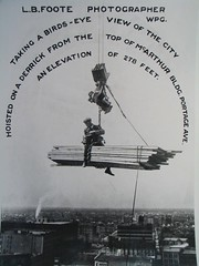 Foote on a derrick McArthur bldng 1906