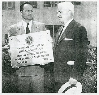 "Showing off the ""Most Beautiful Steel Bridge"" plaque (1955)"