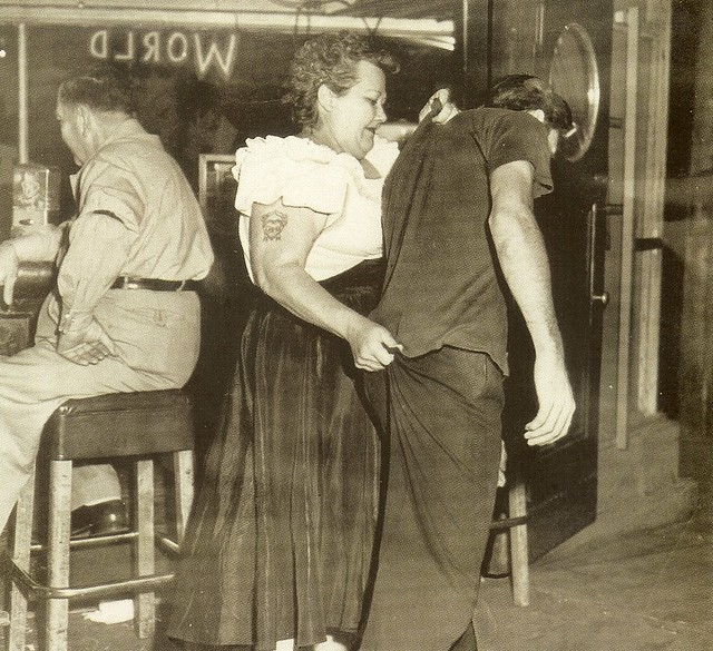 bouncer cairo mary escorts another customer to the door of shanghai reds beacon and 5th street San Pedro 1953