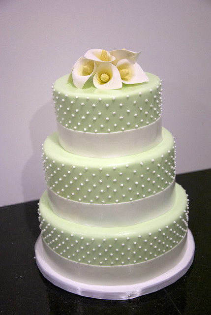 calla lily dotted wedding cake This 3 tier pale green wedding cake is