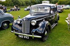 packard super eight(0.0), touring car(0.0), automobile(1.0), packard 120(1.0), rolls-royce phantom iii(1.0), vehicle(1.0), antique car(1.0), sedan(1.0), vintage car(1.0), land vehicle(1.0), luxury vehicle(1.0), motor vehicle(1.0), classic(1.0),