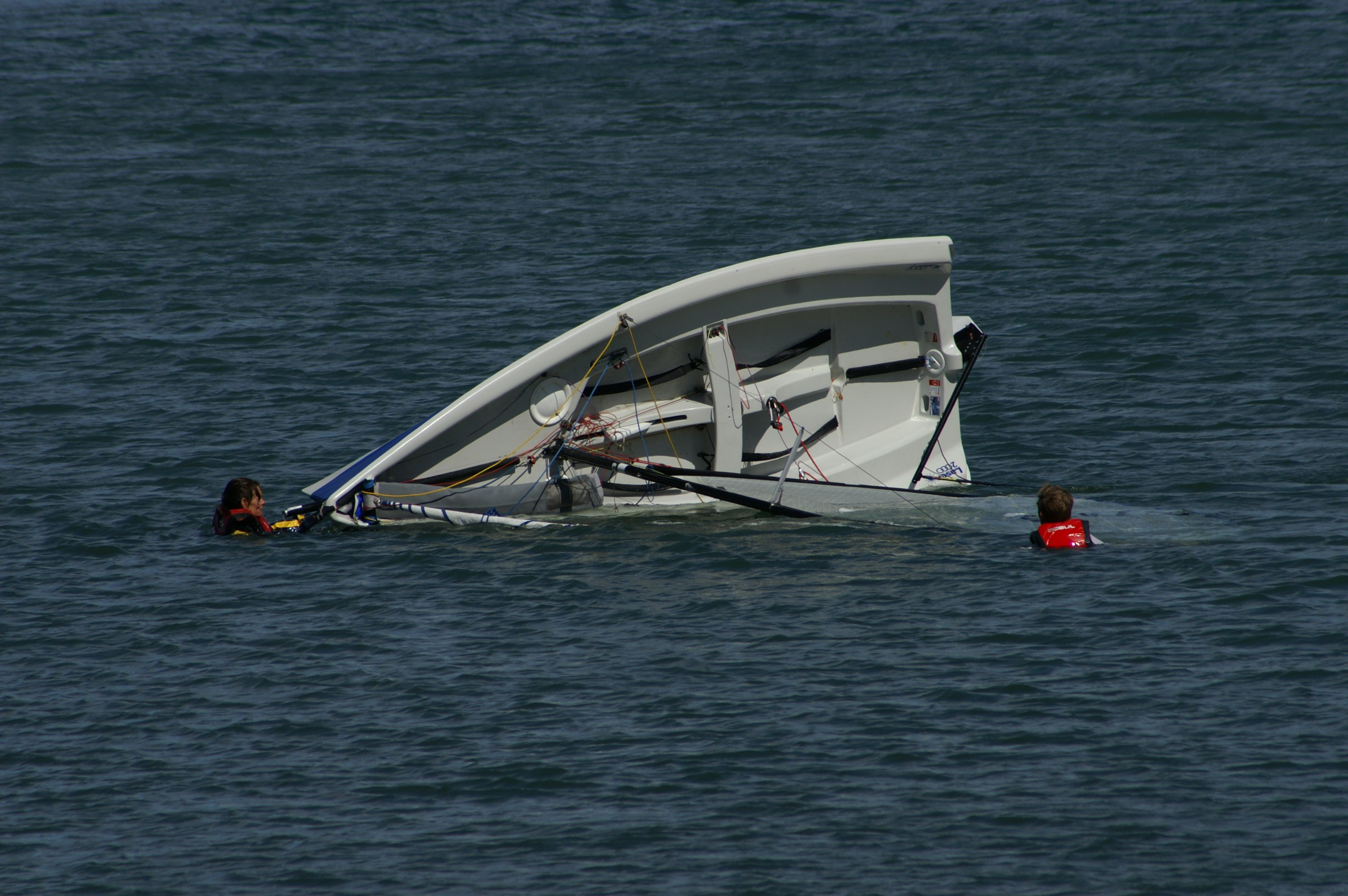 Tipping boat leaves people stranded in ocean