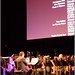 Andy Farber conducts through the credits of 'Louis' at the Apollo Theater in Harlem
