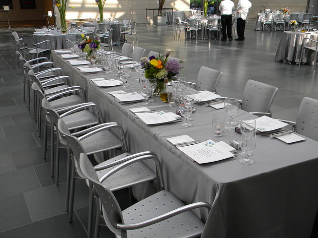 Silver tablecloths play off brushed aluminum chairs