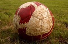ball(1.0), grass(1.0), red(1.0), ball(1.0), football(1.0),