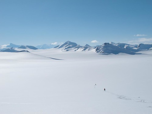 Dylan Taylor and Danny Uhlmann crossing the Chisana Glacier on a 100-mile ski/hike from Skolai Pass to McCarthy, Wrangell Mountains, Alaska.