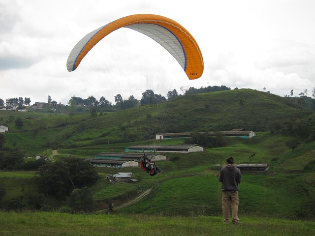 A paraglider comes in for a landing.