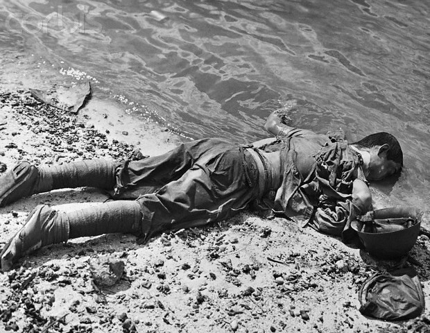 A Japanese soldier lies dead face down in the surf at the end of the Battle of Saipan in the Northern Marinana Islands 1944
