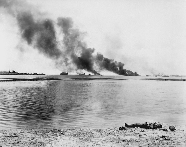 Japanese soldiers attempted to retreat to their boats in Tanapag harbor and were slaughtered on the beach, Saipan, by Angus Robertson 1944