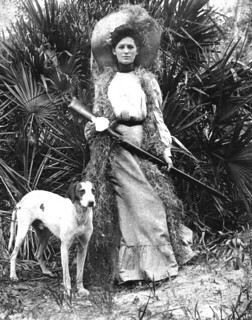 Woman with rifle and dog
