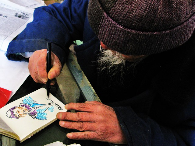 Dr. Ho signs Todd's drawing - Baisha, near Lijiang, China