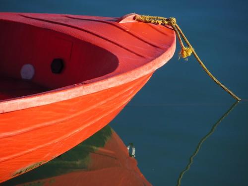 Akaroa, New Zealand South Island - Red Boat near Dock