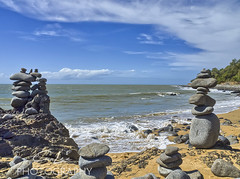 Rocks piled high at a stretch of beach north of Cairns