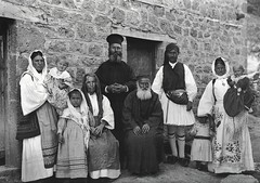 A family and their priest in Zemeno, Corinth, by Fréderic Boissonnas 1903
