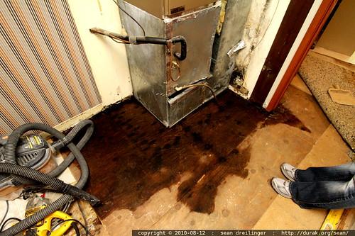 soaking wet plywood subfloor around the furnace