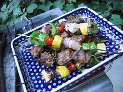 outdoor grill(0.0), barbecue(0.0), barbecue grill(0.0), meal(1.0), grilling(1.0), brochette(1.0), meat(1.0), food(1.0), dish(1.0), shashlik(1.0), kebab(1.0), cuisine(1.0), skewer(1.0), grilled food(1.0),