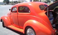 auto show(0.0), automobile(1.0), automotive exterior(1.0), 1937 ford(1.0), wheel(1.0), vehicle(1.0), automotive design(1.0), hot rod(1.0), antique car(1.0), vintage car(1.0), land vehicle(1.0), motor vehicle(1.0),
