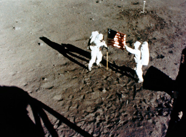Neil Armstrong and Buzz Aldrin deploying the U.S. Flag.