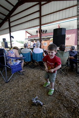 band plays onstage, sequoia plays transformers in th…