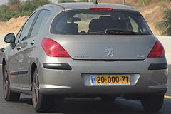 peugeot 307(0.0), race car(1.0), automobile(1.0), automotive exterior(1.0), peugeot(1.0), peugeot 308(1.0), family car(1.0), vehicle(1.0), bumper(1.0), land vehicle(1.0), luxury vehicle(1.0),