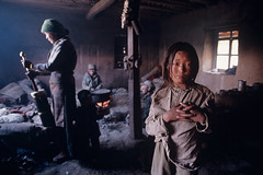 Families drinking and preparing tea in their homes in Amdo, Shigatse, Tibet, 1989, by Steve McCurry