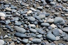 asphalt(0.0), boulder(0.0), stone wall(0.0), stream bed(0.0), road surface(0.0), rubble(1.0), cobblestone(1.0), pebble(1.0), rock(1.0), gravel(1.0),