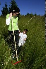 rachel clears a path for sequoia through the tall grass
