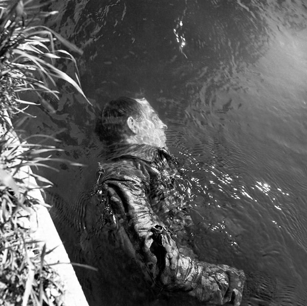 Lee Miller, Dead SS Guard in the Canal, Dachau, Germany, 1945