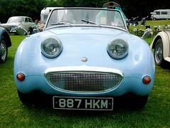 race car(0.0), tvr(0.0), automobile(1.0), vehicle(1.0), antique car(1.0), austin-healey sprite(1.0), land vehicle(1.0), convertible(1.0), sports car(1.0),