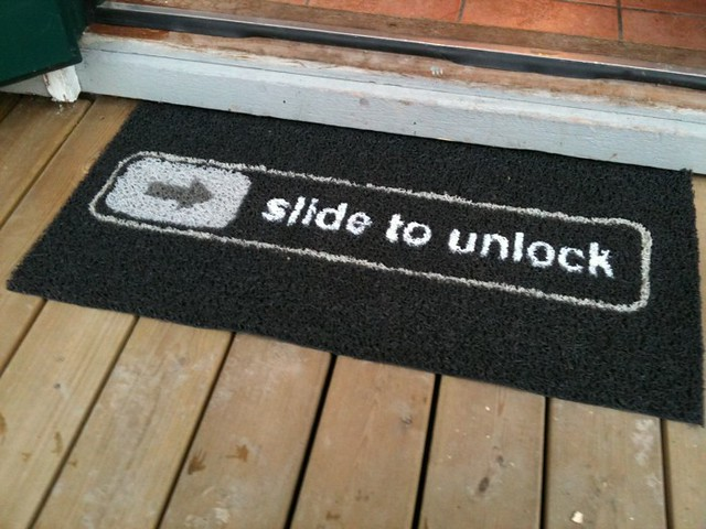 """Slide to unlock"" doormat"