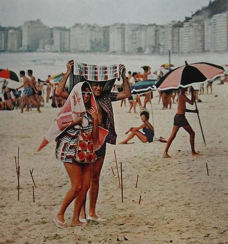 1962 vintage beach photo man woman blanket sunglasses smiling 1960s