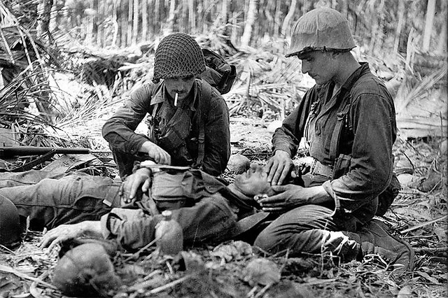 Two American soldiers tend to an injured Australian, New Guinea, by George Silk 1942
